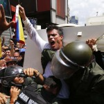 Venezuelan opposition leader Leopoldo Lopez gets into a National Guard armored vehicle in Caracas