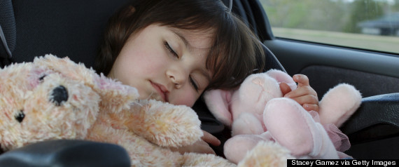 toddler sleeping in car