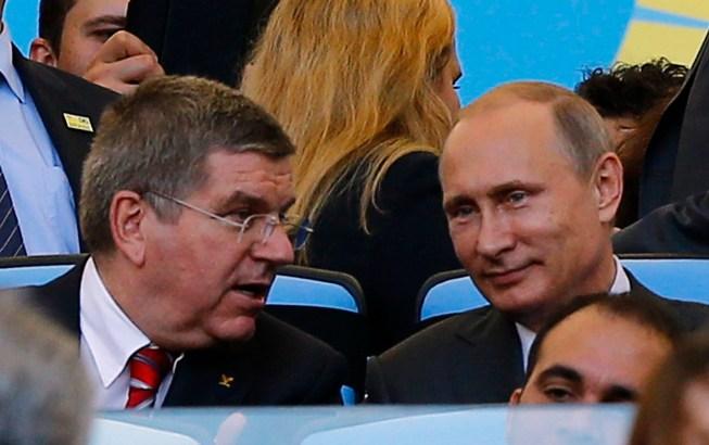 Russia President Vladimir Putin talks with International Olympic Committee President Thomas Bach