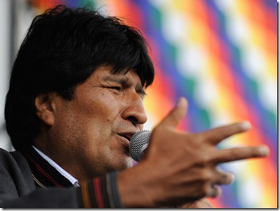 "Bolivian President Evo Morales delivers a speech during the celebration for the reincorporation of Bolivia to the UN Convention Against Illicit Traffic in Narcotic Drugs in La Paz on January 14, 2013. ""The coca leaf is not any more seen as cocaine (..), it is a victory of our identity"" said Morales. AFP PHOTO/Jorge Bernal"