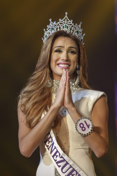 Isabella Santiago of Venezuela gives a traditional greeting after she was crowned Miss International Queen in Pattaya