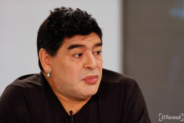 Argentina's soccer legend Diego Maradona looks on as he hosts his television show 'De Zurda' in Caracas