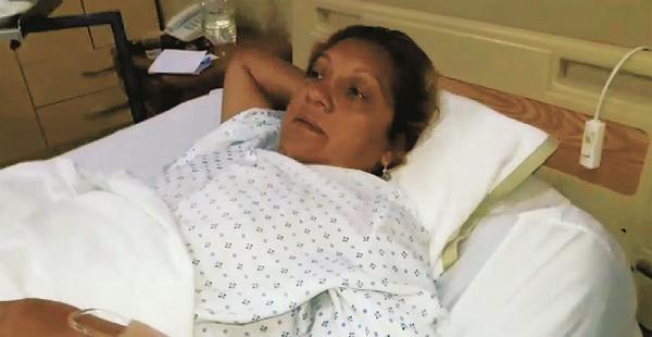 María Sandóval, cambista herida. Es la tercera vez que la asaltan