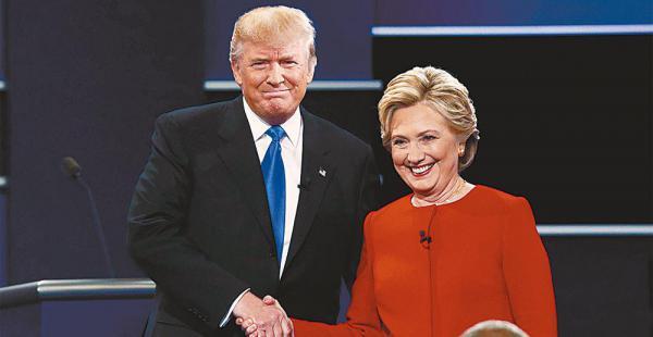 Una escena inusual. Trump y Clinton se saludaron con un apretón de manos al inicio del debate