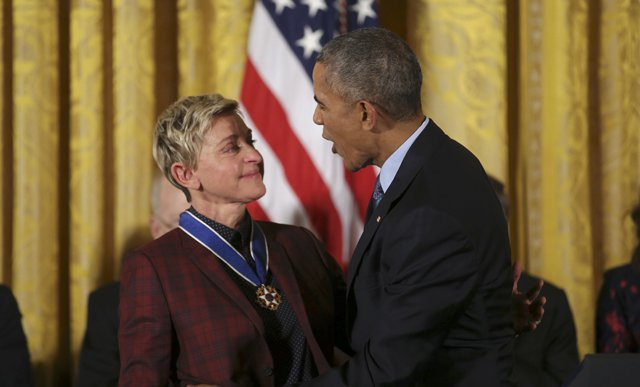 U.S. President Barack Obama reacts with comedian and talk show host Ellen DeGeneres after presenting the Presidential Medal of Freedom to DeGeneres during a ceremony in the White House East Room in Washington, U.S., November 22, 2016. REUTERS/Carlos Barria
