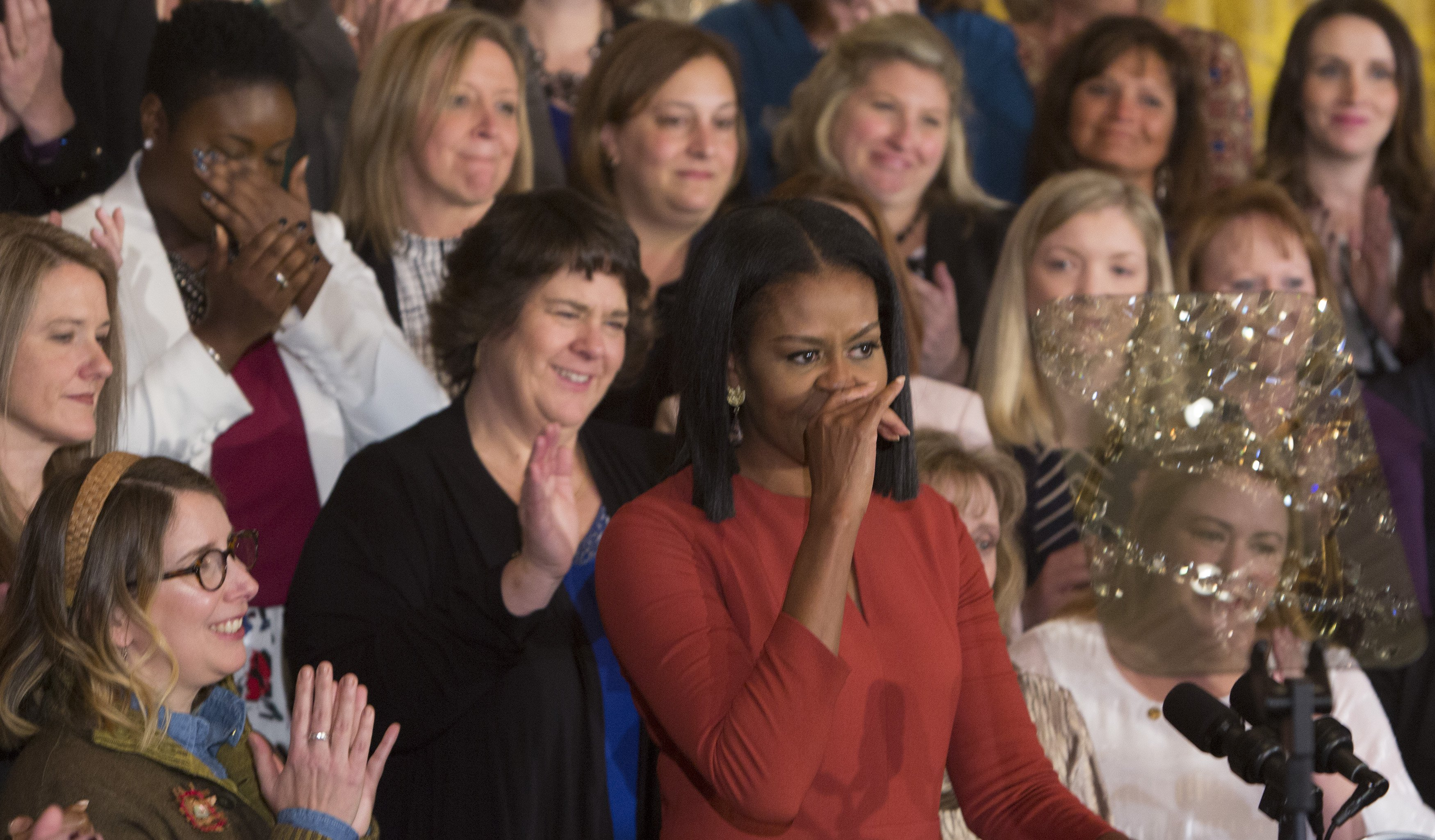 Michelle Obama pause to control her emotions as she gives her final remarks as US First Lady at the 2017 School Counselor of the Year event at the White House in Washington DC, January 5, 2017.  / AFP PHOTO / CHRIS KLEPONIS