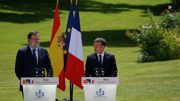 Los mandatarios español y francés durante una conferencia de prensa conjunta (AFP)