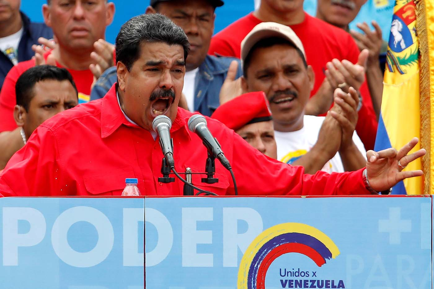 """FILE PHOTO: Venezuela's President Nicolas Maduro delivers a speech during the closing campaign ceremony for the upcoming Constituent Assembly election in Caracas, Venezuela July 27, 2017 . The banner reads """"Power"""". REUTERS/Carlos Garcias Rawlins/File Photo"""