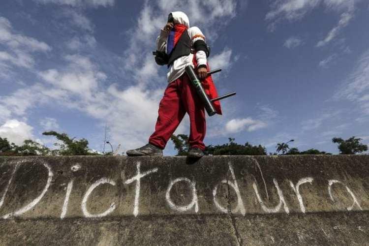 """""""Dictadura"""", la palabra más representativa de lo que ocurre en la Venezuela de Nicolás Maduro. La comunidad internacional no reconocerá los resultados de los comicios de este domingo (EFE)"""