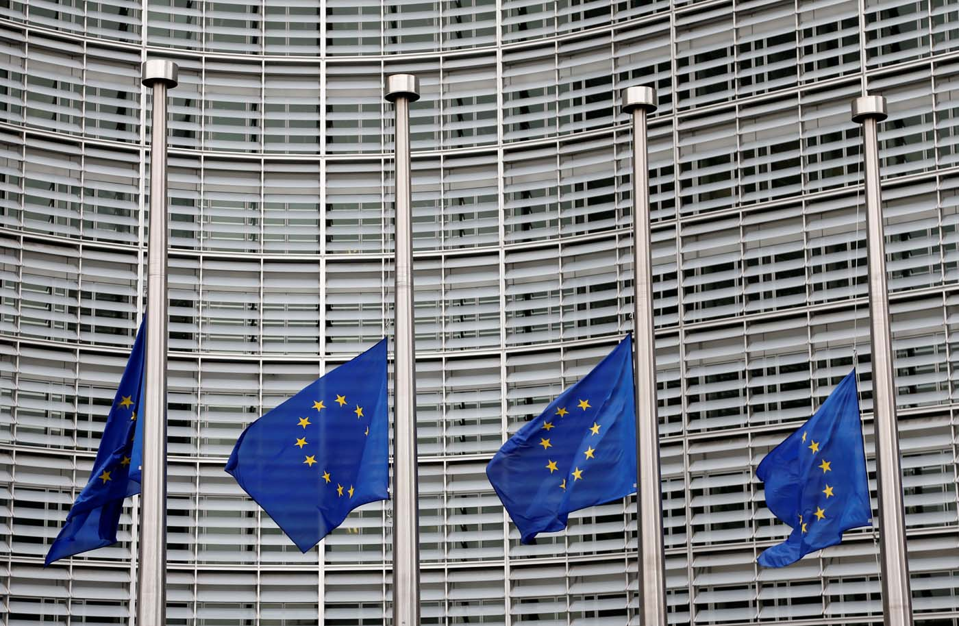 European Union flags are lowered at half-mast in honor of the victims of the Barcelona attack, outside the European Commission headquarters in Brussels, Belgium August 18, 2017. REUTERS/Francois Lenoir