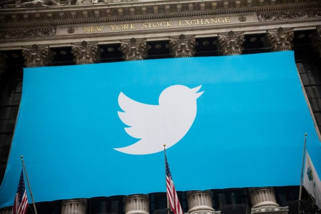 (FILES) This file photo taken on November 6, 2013 shows the Twitter logo displayed on a banner outside the New York Stock Exchange (NYSE) in New York. US stocks rose early October 5, 2016 with petroleum-linked shares rallying on higher oil prices and Twitter advancing on a report it is closer to being sold. Devon Energy rose 1.5 percent and Marathon Oil 1.8 percent as oil prices jumped ahead of a weekly US petroleum inventory report. Twitter gained 4.1 percent after the Wall Street Journal reported the social media company is expected to receive takeover bids this week. Possible suitors include Salesforce.com, Google and Disney. / AFP PHOTO / GETTY IMAGES NORTH AMERICA / Andrew Burton