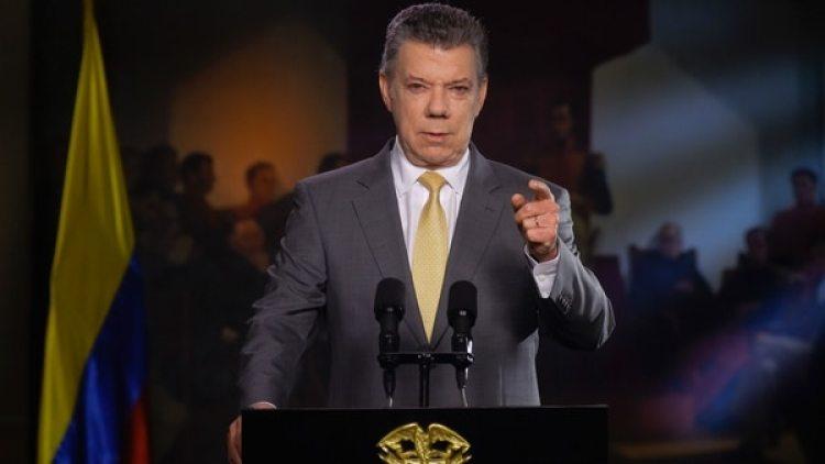 El presidente Juan Manuel Santos durante su discurso en la televisión en el que anuncio el aval de la Corte a la JEP. (AFP)