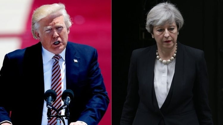 Donald Trump y Theresa May (AFP)