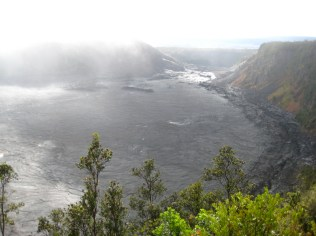 Kilauea Iki from the trailhead. The trail follows the right rim, then comes back across the middle.