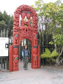 Amy at the gates of the Whaka thermal reserve and Maori Arts and Crafts Institute.
