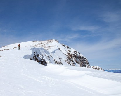Scott skis the cornice near the summit...