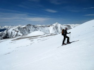 Jake nearing the summit with spectacular views all around.