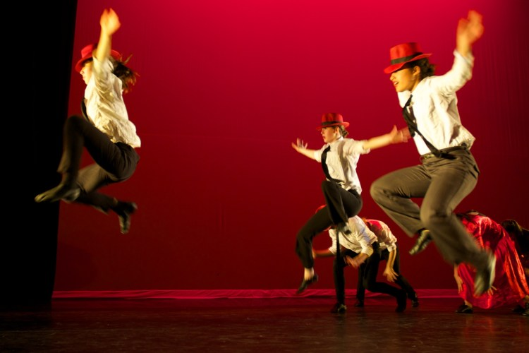 Dancers jumping on stage