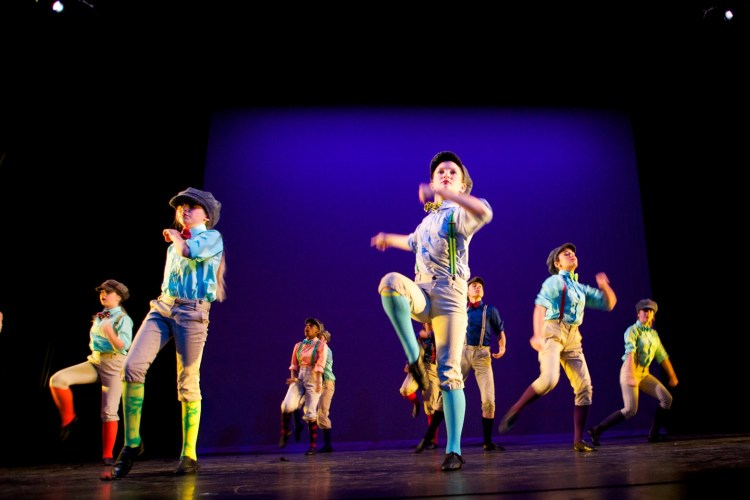 young dancers in costume on stage