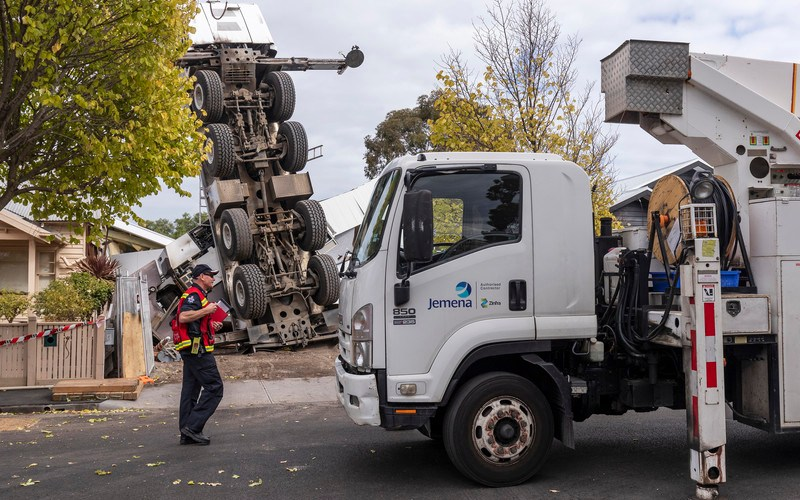 Photo story: Crane topples on two houses in Melbourne
