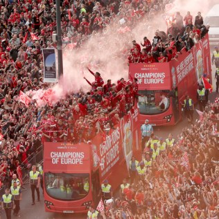 epa07620955 Liverpool supporters greet the team during the Liverpool victory parade in Liverpool, Britain, 02 June 2019. Liverpool FC won the UEFA Champions league final against Tottenham Hotspurs at the Wanda Metropolitano stadium in Madrid, Spain. EPA-EFE/JON SUPER