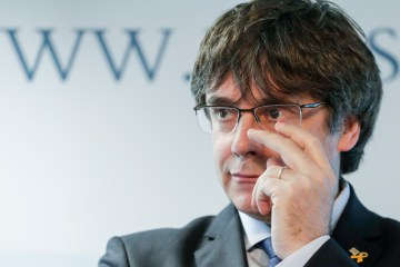 Catalan separatist leader Puigdemont detained in Italy must face Spanish courts