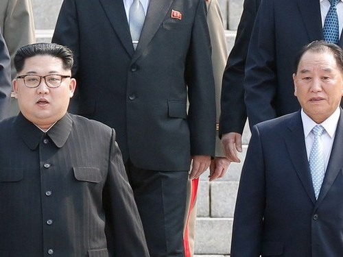 North Korean official reported to be in a labour camp appears alongside Kim Jong-un
