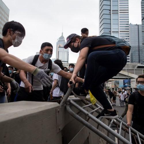 Hong Kong postpones debate of controversial bill (Updated)