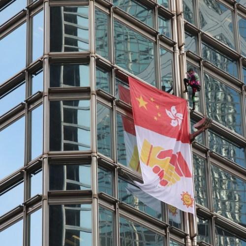 Banner urging peace unfurled on Hong Kong skyscraper, calls for boycott of Disney's 'Mulan'