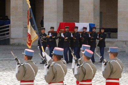 French Republican guards carry the flag-draped coffin of late French President Jacques Chirac during a military funeral honors ceremony at the Hotel des Invalides during a national day of mourning in Paris, France, 30 September 2019. EPA-EFE/PHILIPPE WOJAZER / POOL