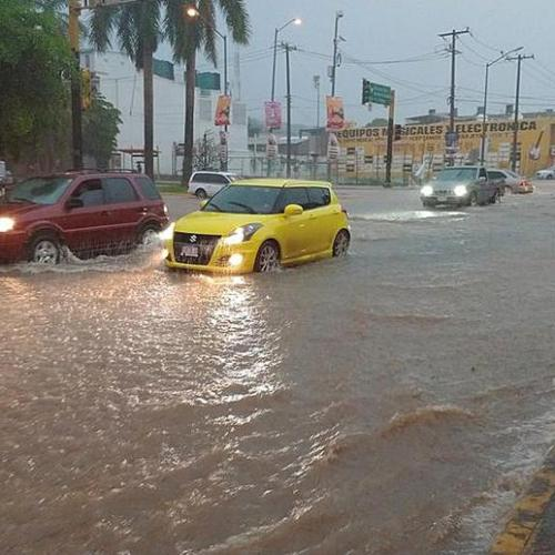 Photo Story: Rain cause by Tropical Storm Lorena hit Mexico