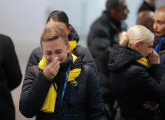 epa08141103 A crew member of a UIA airlines reacts after she pay tribute to crew members and victims of the Ukraine International Airlines Flight PS752 at Boryspil International Airport in Kiev, Ukraine, 19 January 2020 after their bodies were returned from Iran. Iran admitted on 11 January that its armed forces had downed a Ukraine International Airlines passenger jet with 176 civilians on board and said it had been an involuntary human error. EPA-EFE/SERGEY DOLZHENKO