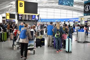 Travellers complain of queues and 'chaos' at British airports as thousands jet off for summer