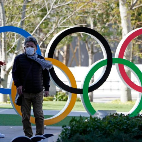 Japan says Olympics must not burden medical systems
