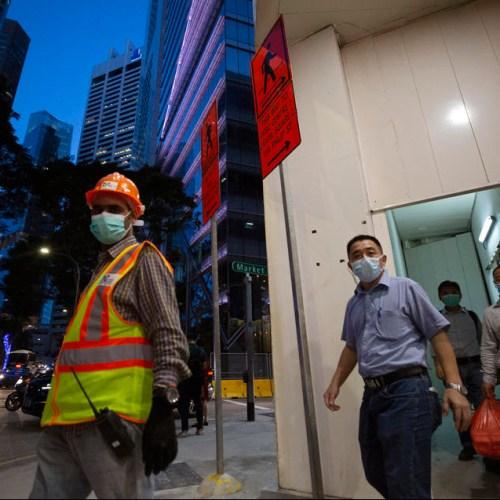 Singapore quarantines 20,000 migrant workers