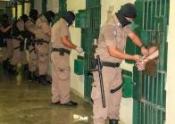 epa08385621 A handout photo made available by the El Salvador Presidency shows a jail guard during an inspection of inmates at the Maximum Security Jail in Zacatecoluca, El Salvador, 25 April 2020 (issued 26 April 2020). Salvadorean President Nayib Bukele ordered jails to impose solitary confinement of gang leader inmates, following a wave of homicides in the country. Investigations have uncovered that part of the homicides were ordered from gang leaders in jails. EPA-EFE/El Salvador Presidency / HANDOUT HANDOUT EDITORIAL USE ONLY/NO SALES
