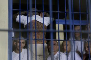 epa08388093 Members of Barrio 18 gang remain in a cell at the Penitentiary Complex in Izalco, El Salvador, 27 April 2020. Salvadorean President Nayib Bukele ordered jails to impose solitary confinement of gang leader inmates, following a wave of homicides in the country, stating that the gangs were 'taking advantage of pandemic'. Investigations have uncovered that part of the homicides were ordered from gang leaders in jails. EPA-EFE/Rodrigo Sura