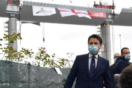 epa08388760 Italian Prime Minister Giuseppe Conte wearing a protective face mask arrives for the inauguration ceremony of the last part of the deck of the new Genoa motorway bridge in Genoa, Italy, 28 April 2020. The new Genoa bridge, designed by architect Renzo Piano, will be inaugurated 28 April in the presence of Prime Minister Conte. The new bridge is under construction after the Morandi highway bridge partially collapsed on 14 August 2018, killing a total of 43 people. EPA-EFE/LUCA ZENNARO