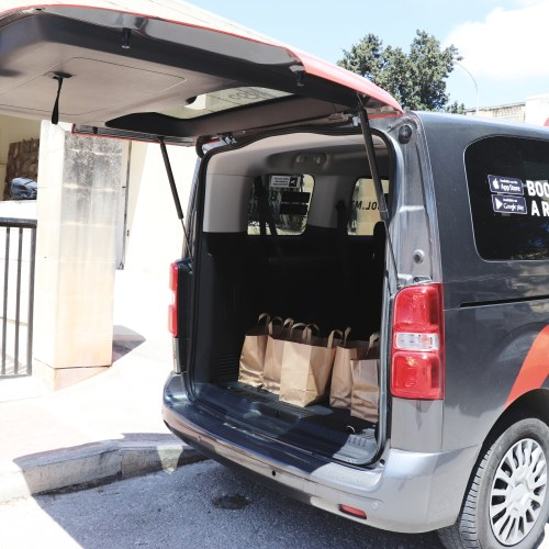 Cool teams up with Caritas to deliver food for those in need