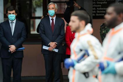 epa08391972 Portuguese Defence Minister Joao Gomes Cravinho (2-L) and Portuguese Education Minister Tiago Brandao Rodrigues (L) attend a demonstration of a disinfection action at the Amadora Secondary School, in Amadora, Portugal, 29 April 2020. The action was carried out by elements of the Military Police equipped with protective suits, as a measure to stem the widespread of the SARS-CoV-2 coronavirus that causes the COVID-19 disease. Schools all over the country are part of the operation, which involves more than 400 military personnel of the three branches of the Armed Forces. EPA-EFE/MIGUEL A. LOPES