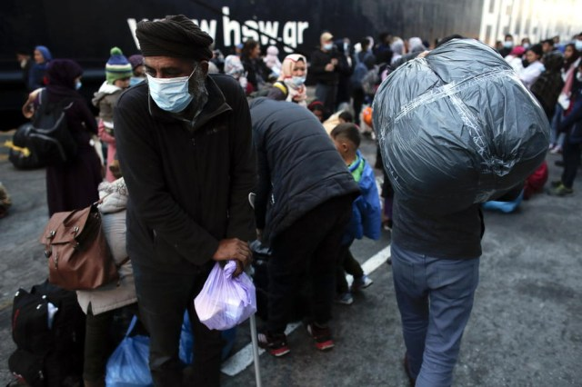 Migrants and refugees arrive from Mytilene at Port of Piraeus in Greece