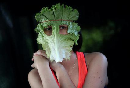 epa08413437 Social media manager and vegan activist Ecemsu Lee poses with a mask made of lettuce (green leaf) to draw attention to viruses spread by infected animals and the consumption of animal products, in Istanbul, Turkey, 28 April 2020 (issued 10 May 2020). Turkish vegan activists pose with masks made with vegetables to draw attention to different viruses, like covid19, SARS and MERS, believed to be originating from eating or being close to infected animals. Vegan movements around the world aim to draw attention to the vegan lifestyle as a solution to prevent animal viruses from spreading further. EPA-EFE/SEDAT SUNA ATTENTION: This Image is part of a PHOTO SET