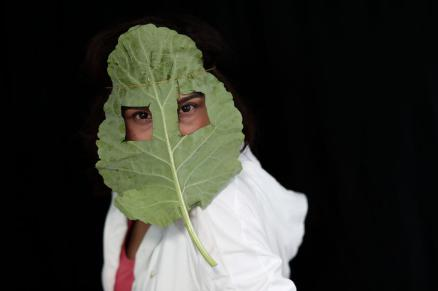 epaselect epa08413432 Dietician vegan activist Kevser Baskara, poses with a mask made of lettuce (iceberg) to draw attention to viruses spread by infected animals and the consumption of animal products, in Istanbul, Turkey, 08 May 2020 (issued 10 May 2020). Turkish vegan activists pose with masks made with vegetables to draw attention to different viruses, like covid19, SARS and MERS, believed to be originating from eating or being close to infected animals. Vegan movements around the world aim to draw attention to the vegan lifestyle as a solution to prevent animal viruses from spreading further. EPA-EFE/SEDAT SUNA ATTENTION: This Image is part of a PHOTO SET