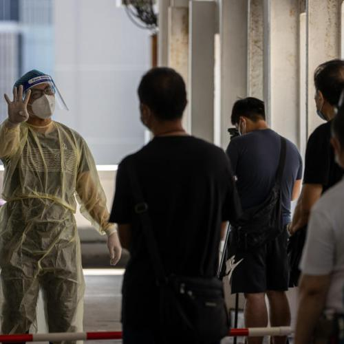Hong Kong mandates masks in all indoor public areas as it reports record daily rise