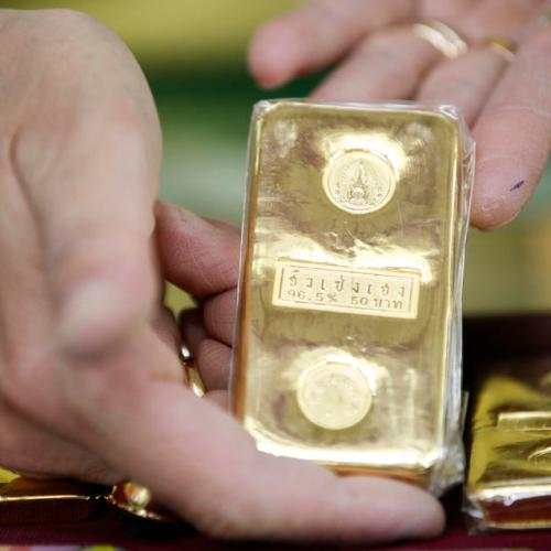 Gold slips as investors book profit, holds on to near 9-year high