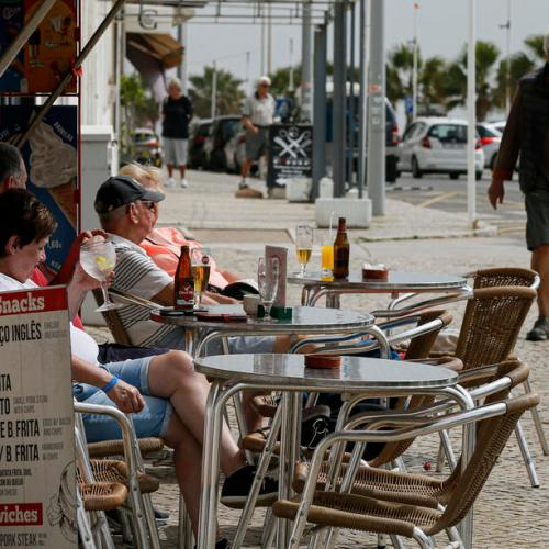 British flock to Portugal's Algarve as quarantine rules lifted, airport struggles