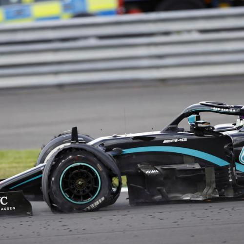 Lewis Hamilton limps on three wheels to win British GrandPrix