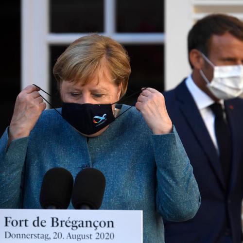 Merkel, Macron agree to coordinate more on coronavirus travel restrictions
