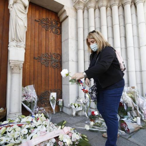 Nice residents mourn church attack dead