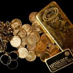 Gold slips as firm dollar, bond yields dent safe-haven appeal